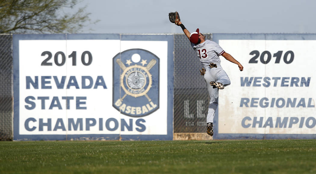 Desert Oasis's Nic Lane (13) catches a fly ball during the fifth inning of a high school baseball game against Sierra Vista's at Sierra Vista High School on Thursday, March 16, 2017, in Las Vegas. ...