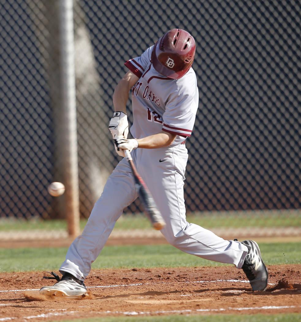 Desert Oasis's Jason Sharman (12) swings during the third inning of a high school baseball game against Sierra Vista at Sierra Vista High School on Thursday, March 16, 2017, in Las Vegas. Desert O ...