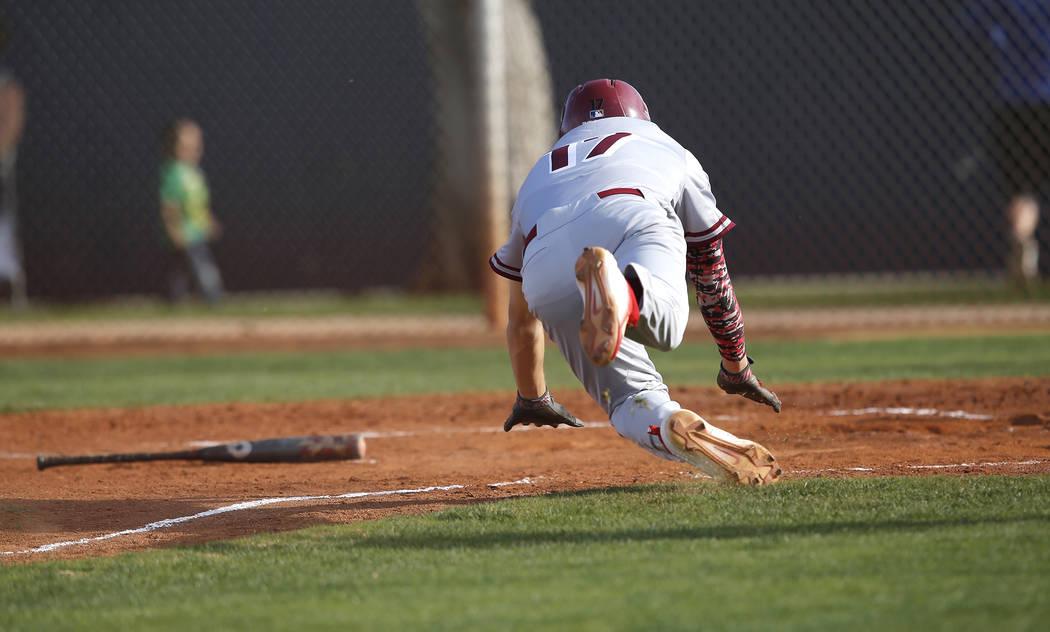 Desert Oasis's Ty Spiegel (17) scores a run during the fifth inning of a high school baseball game against Sierra Vista at Sierra Vista High School on Thursday, March 16, 2017, in Las Vegas. Deser ...