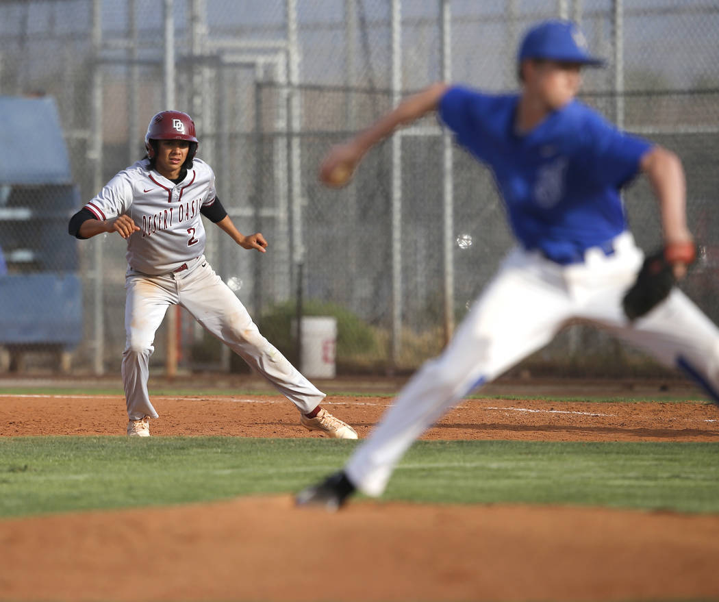 Desert Oasis's Andrew Martinez (2) leads off first base during the sixth inning of a high school baseball game against Sierra Vista at Sierra Vista High School on Thursday, March 16, 2017, in Las  ...