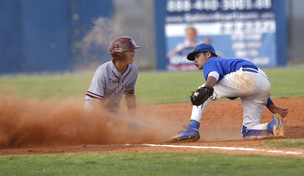 Desert Oasis's Cole Schaefer (10) is safe at third base after a late catch by Sierra Vista's Nicholas Morice (13) during the seventh inning of a high school baseball game at Sierra Vista High Scho ...