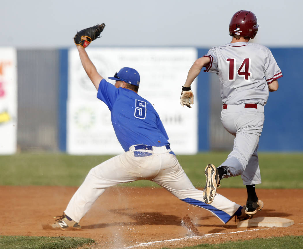 Desert Oasis's Jake Schmidt (14) is out at first base after a catch by Sierra Vista's Daymien Yohner (5) during the seventh inning of a high school baseball game at Sierra Vista High School on Thu ...