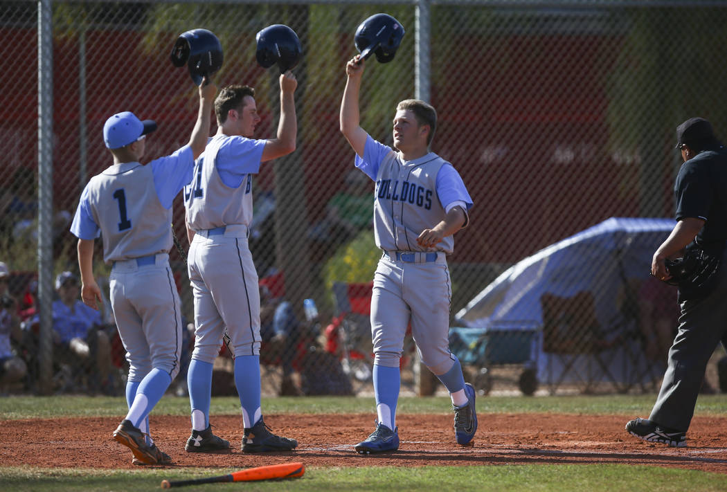 Centennial's Austin Kryszczuk (17), right, celebrates his home run hit during a baseball game at Arbor View High School in Las Vegas on Friday, March 17, 2017. Centennial won 5-2. (Chase Stevens/L ...