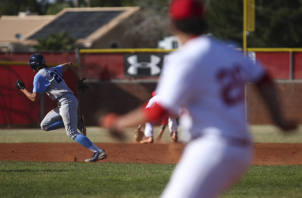Centennial's Brett Berger (20) runs for third base during a baseball game against Arbor View High School in Las Vegas on Friday, March 17, 2017. Centennial won 5-2. (Chase Stevens/Las Vegas Review ...