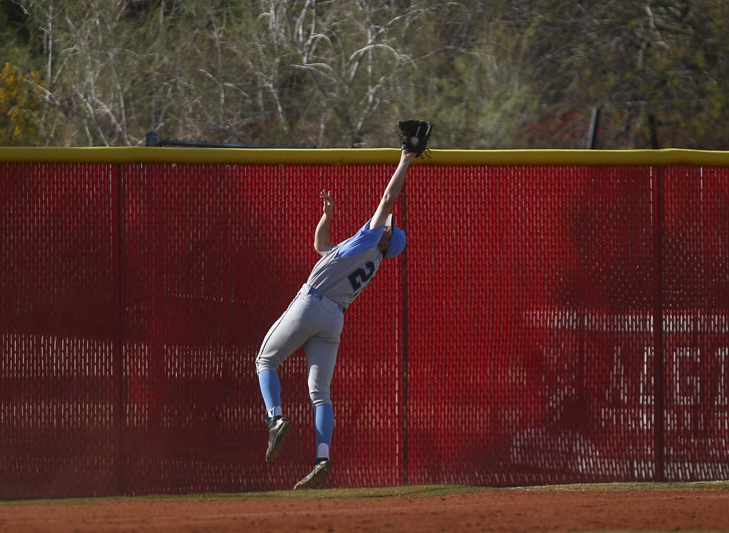 Centennial's Garrett Holden (21) catches a fly ball from Arbor View's Nick Cornman (4) during a baseball game at Arbor View High School in Las Vegas on Friday, March 17, 2017. Centennial won 5-2.  ...
