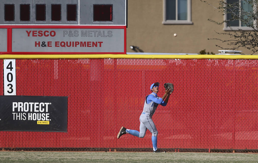 Centennial's Gino Sabey (12) catches a fly ball from Arbor View's Joe Fitzhugh (20) during a baseball game at Arbor View High School in Las Vegas on Friday, March 17, 2017. Centennial won 5-2. (Ch ...