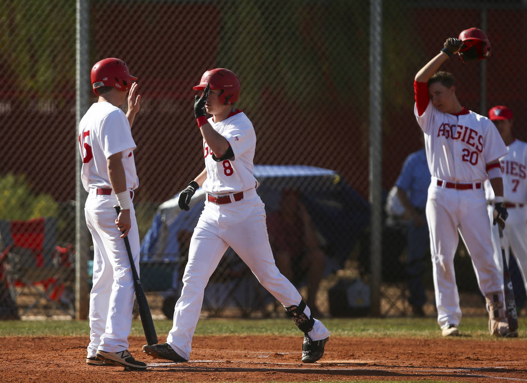 Arbor View's Logan Santos (8) celebrates his home run with Arbor View's Jacob Hamilton (15) in the first inning during a baseball game at Arbor View High School in Las Vegas on Friday, March 17, 2 ...