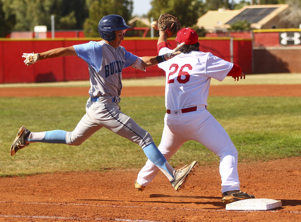 Centennial's Zachary Hare (5) is tagged out by Arbor View's John Edwards (26) at first base during a baseball game at Arbor View High School in Las Vegas on Friday, March 17, 2017. Centennial won  ...