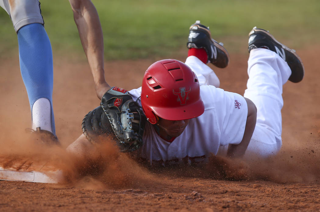 Arbor View's Nick Roeper (11) safely gets to back to first base against Centennial's Brett Berger (20) during a baseball game at Arbor View High School in Las Vegas on Friday, March 17, 2017. Cent ...
