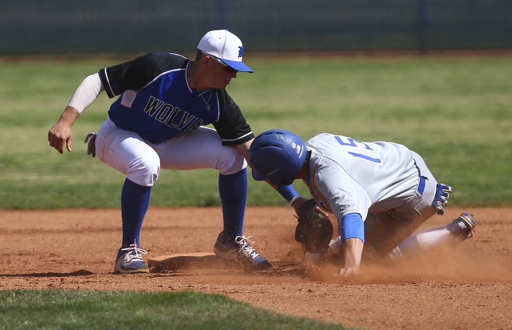 Basic's Paul Myro (21) tags out Santa Margarita's Josh Nicoloff (15), who was attempting to steal second base, during a baseball game at Basic High School in Henderson on Saturday, March 18, 2017. ...
