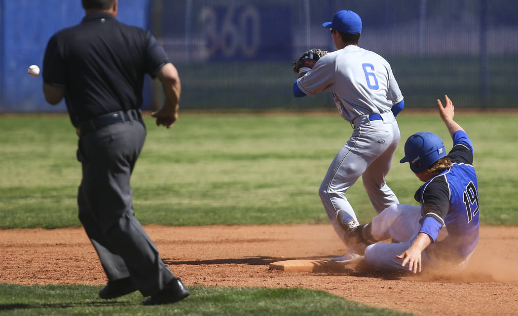 Basic's Jack Wold (19) slides safely into second base against Santa Margarita's Austin Villanueva (6) during a baseball game at Basic High School in Henderson on Saturday, March 18, 2017. Basic wo ...