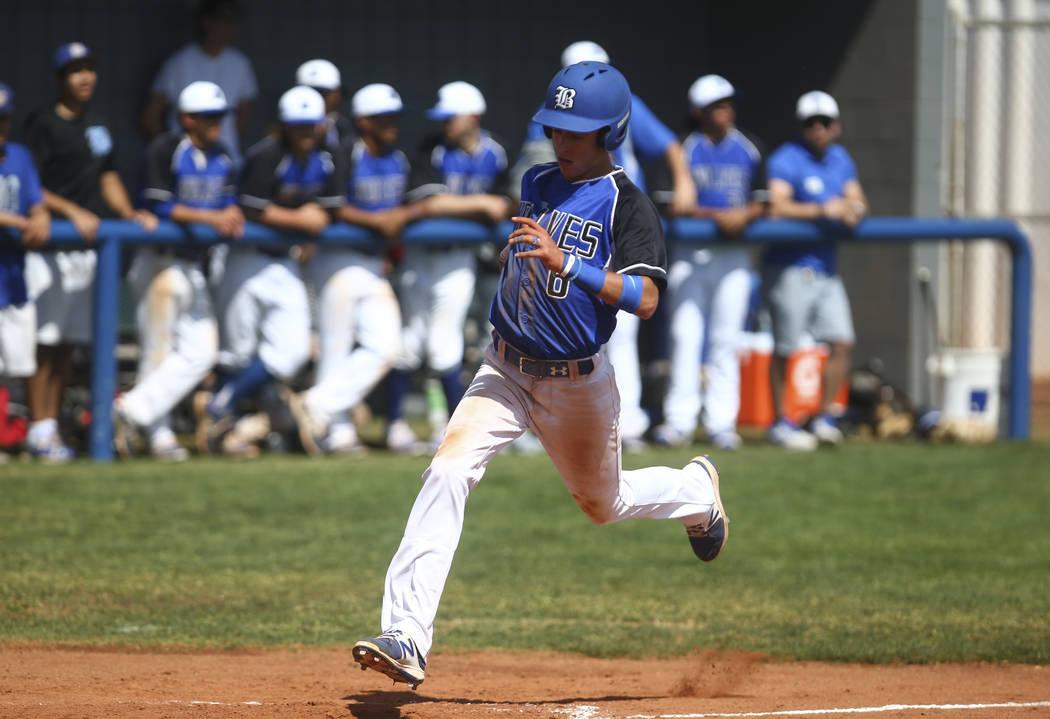 Basic's John Howard Bobo (6) scores a run against Santa Margarita during a baseball game at Basic High School in Henderson on Saturday, March 18, 2017. Basic won 4-3. (Chase Stevens/Las Vegas Revi ...