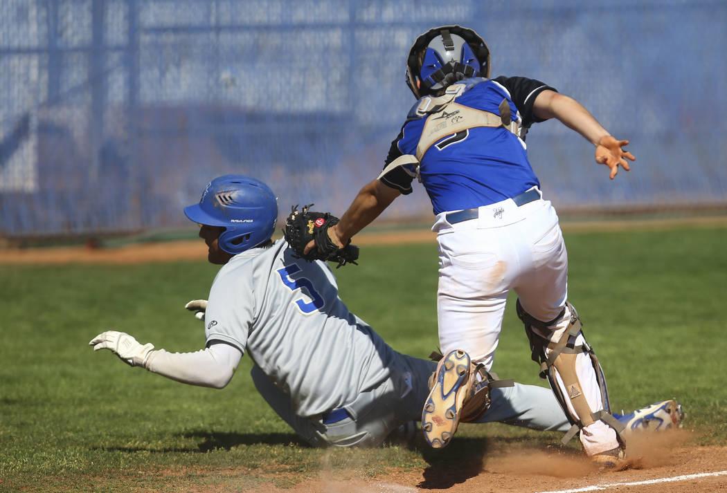 Basic's Roger Riley (3) tags out Santa Margarita's Derek Park (5) during a baseball game at Basic High School in Henderson on Saturday, March 18, 2017. Basic won 4-3. (Chase Stevens/Las Vegas Revi ...