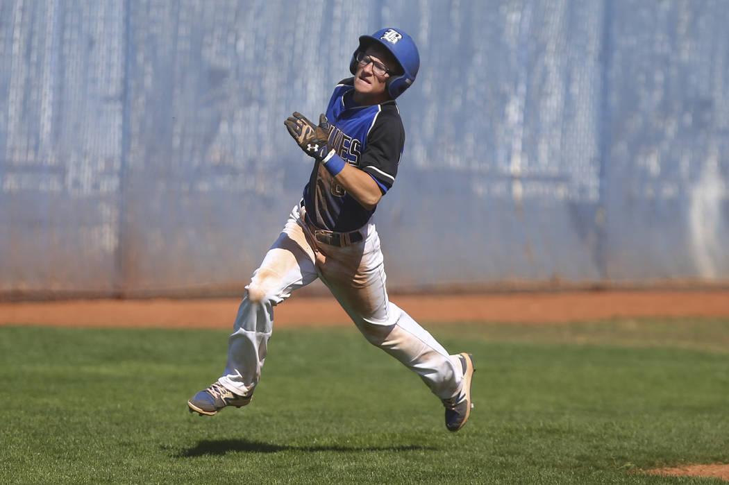 Basic's John Howard Bobo (6) heads for home base to score a run against Santa Margarita  during a baseball game at Basic High School in Henderson on Saturday, March 18, 2017. Basic won 4-3. (Chase ...