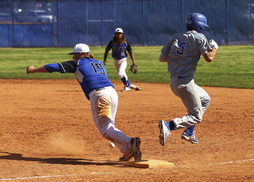 Santa Margarita's Derek Park (5) makes it safely to first base against Basic's Jack Wold (19) during a baseball game at Basic High School in Henderson on Saturday, March 18, 2017. Basic won 4-3. ( ...