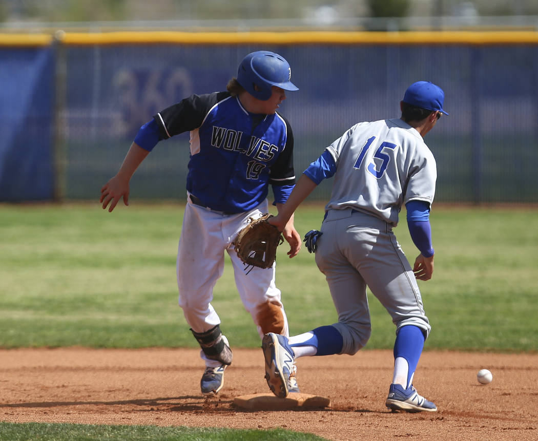 Basic's Jack Wold (19) makes it safely to second base against Santa Margarita's Josh Nicoloff (15) during a baseball game at Basic High School in Henderson on Saturday, March 18, 2017. Basic won 4 ...