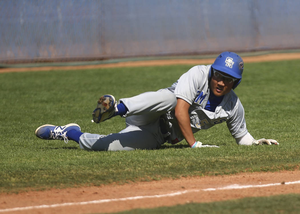 Santa Margarita's Derek Park (5) trips up before getting tagged out by Basic during a baseball game at Basic High School in Henderson on Saturday, March 18, 2017. Basic won 4-3. (Chase Stevens/Las ...