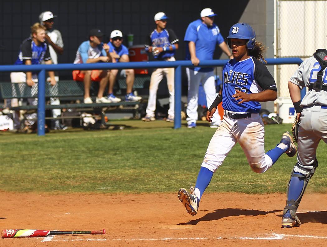 Basic's Christian Rivero (32) scores a run against Santa Margarita during a baseball game at Basic High School in Henderson on Saturday, March 18, 2017. Basic won 4-3. (Chase Stevens/Las Vegas Rev ...