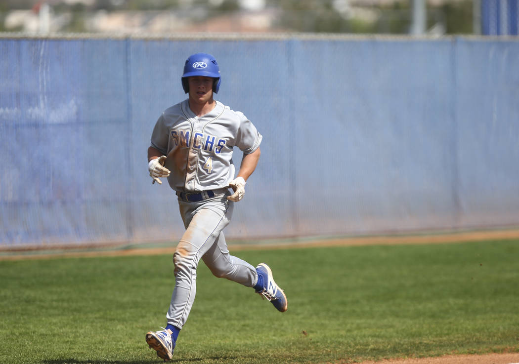 Santa Margarita's Conner Longrie (4) heads for home base to score a run against Basic during a baseball game at Basic High School in Henderson on Saturday, March 18, 2017. Basic won 4-3. (Chase St ...