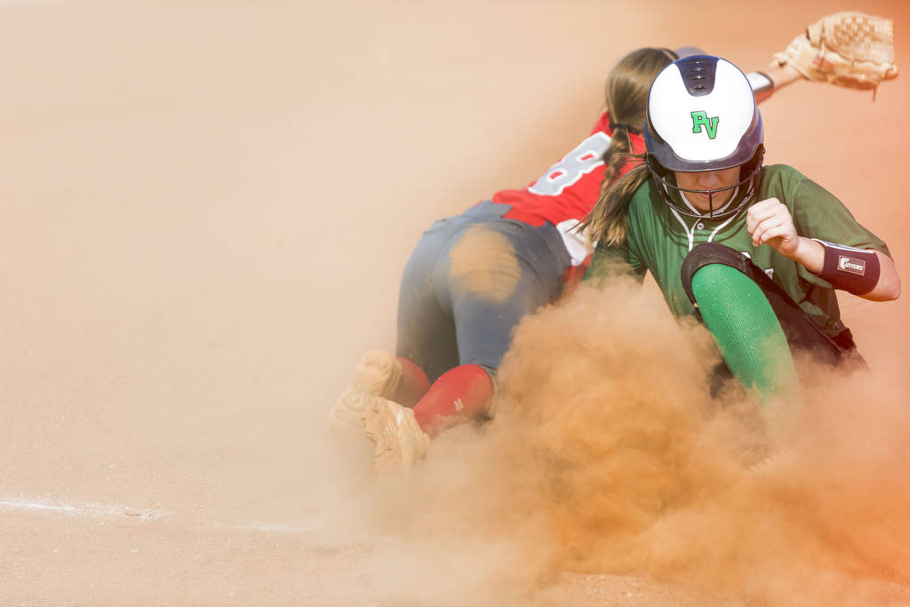 Palo Verde's Makena Martin, right, slides into third base successfully as Arbor View's Adriana Thomason (8) tries to reach a ball during the second inning of a softball game at Arbor View High Sch ...