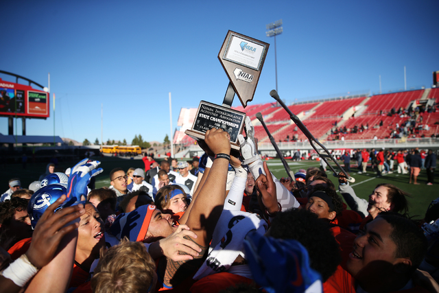 Bishop Gorman celebrates its against Liberty in the Class 4A state football championship game at Sam Boyd Stadium on Saturday, Dec. 3, 2016, in Las Vegas. Bishop Gorman won 84-8. Erik Verduzco/Las ...