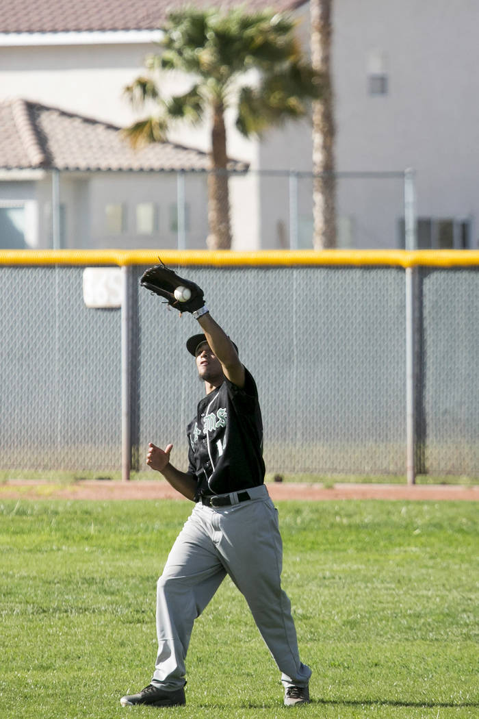 Rancho junior Joseph Walls (14) catches the ball in the outfield during a game against Silverado at Silverado High School on Tuesday, March 21, 2017, in Las Vegas. (Bridget Bennett/Las Vegas Revie ...