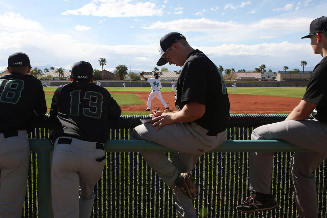 Rancho baseball teammates prepare for a game against Silverado at Silverado High School on Tuesday, March 21, 2017, in Las Vegas. (Bridget Bennett/Las Vegas Review-Journal) @bridgetkb