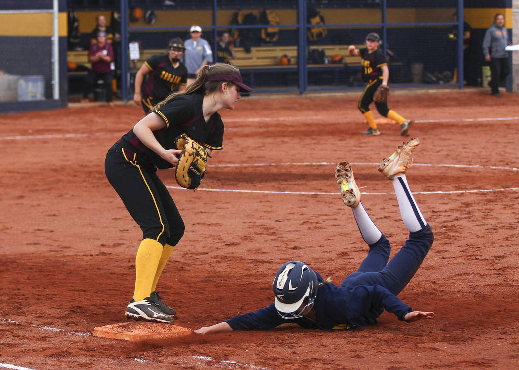 Pahrump's Jill Smith (8) tags out Boulder City's Ellie Ramsey (3) at first base during a softball game at Boulder City High School in Boulder City on Wednesday, March 22, 2017. (Chase Stevens/Las  ...