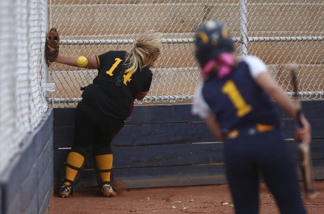 Pahrump's Jordan Egan (14) misses a foul ball from Boulder City's Ellie Ramsey (3) during a softball game at Boulder City High School in Boulder City on Wednesday, March 22, 2017. (Chase Stevens/L ...