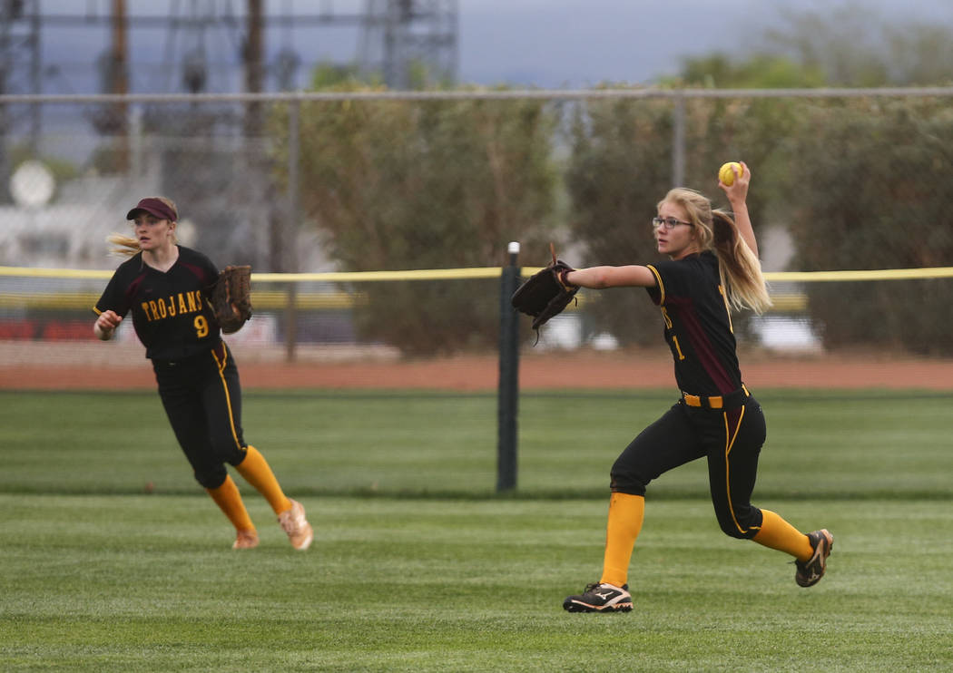Pahrump's Terrena Martin (1) looks to throw after catching a fly ball from Boulder City's Micayla Gegen (1) during a softball game at Boulder City High School in Boulder City on Wednesday, March 2 ...