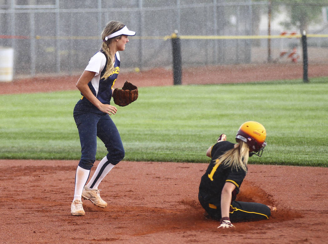 Pahrump's Terrena Martin (1) slides into second base against Boulder City's Ashley Wishard (8) during a softball game at Boulder City High School in Boulder City on Wednesday, March 22, 2017. (Cha ...