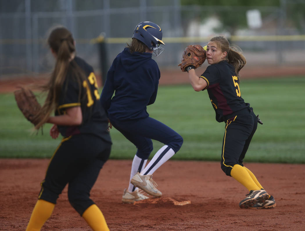 Pahrump's Skyler Lauver (5) looks to throw after tagging out Boulder City's Raegan Herr (5) during a softball game at Boulder City High School in Boulder City on Wednesday, March 22, 2017. (Chase  ...