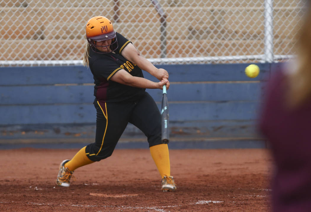 Pahrump's Jordan Egan (14) hits the ball during a softball game at Boulder City High School in Boulder City on Wednesday, March 22, 2017. (Chase Stevens/Las Vegas Review-Journal) @csstevensphoto