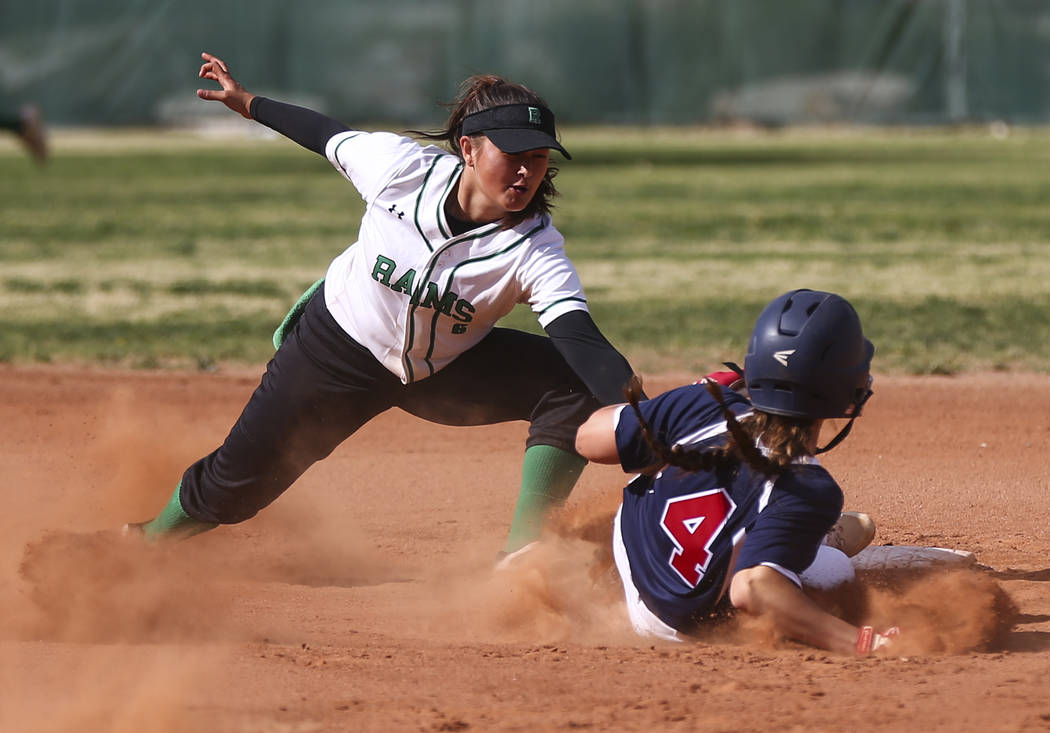 Rancho's Lili Gutierrez (6) tags out Coronado's Dylan Underwood (4) at second base during a softball game at Rancho High School in Las Vegas on Thursday, March 23, 2017. Coronado won 5-1. (Chase S ...