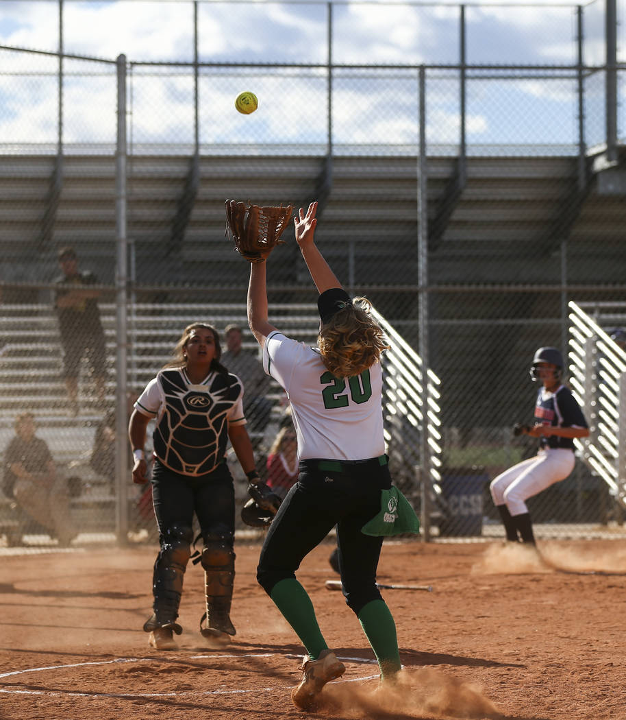 Rancho's MacKenzie Perry (20) catches a foul ball hit by Coronado's Sophia McCann (16) during a softball game at Rancho High School in Las Vegas on Thursday, March 23, 2017. Coronado won 5-1. (Cha ...