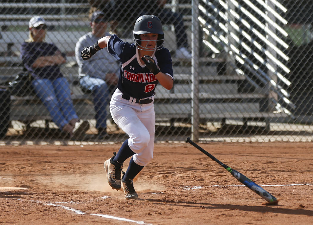 Coronado's Marissa Kopp (8) runs for first base after bunting the ball during a softball game at Rancho High School in Las Vegas on Thursday, March 23, 2017. Coronado won 5-1. (Chase Stevens/Las V ...