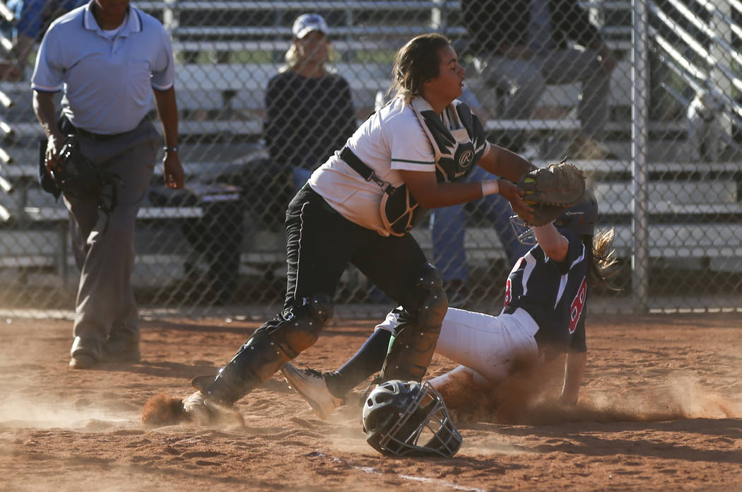 Rancho's Yvette Sanchez (15) tags out Coronado's Marissa Kopp (8) at home base during a softball game at Rancho High School in Las Vegas on Thursday, March 23, 2017. Coronado won 5-1. (Chase Steve ...