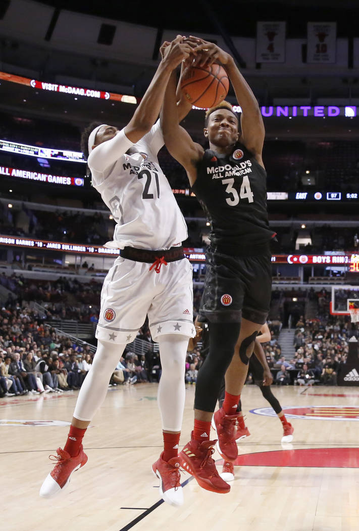 Big West's Chuck O'Bannon Jr. (21) battles Big East's Wendell Carter Jr., for a rebound during the second half of the McDonald's All-American boys basketball game Wednesday, March 29, 2017, in Chi ...