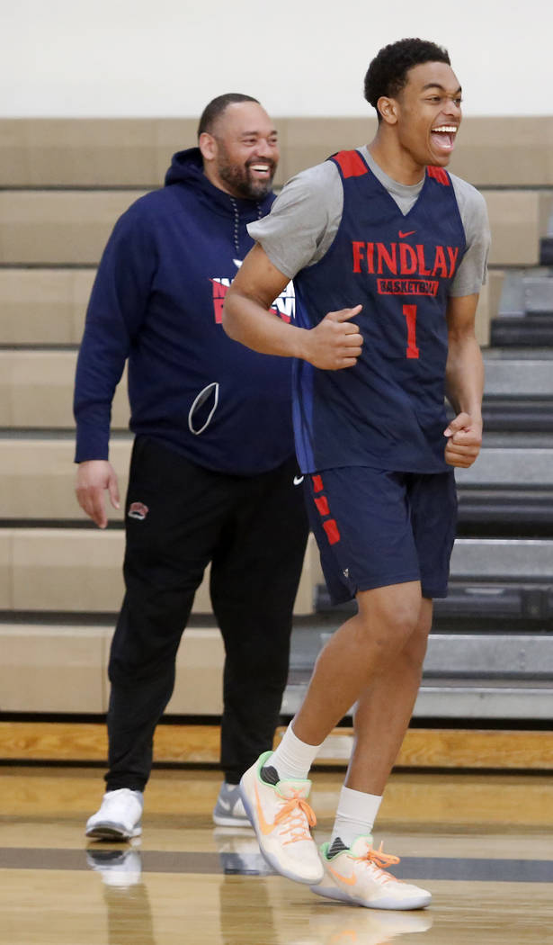 Findlay Prep's Head Coach Paul Washington, left, and P.J. Washington reacts after his teammate dunks during practice at the Henderson International School on Friday, March 24, 2017, in Hend ...