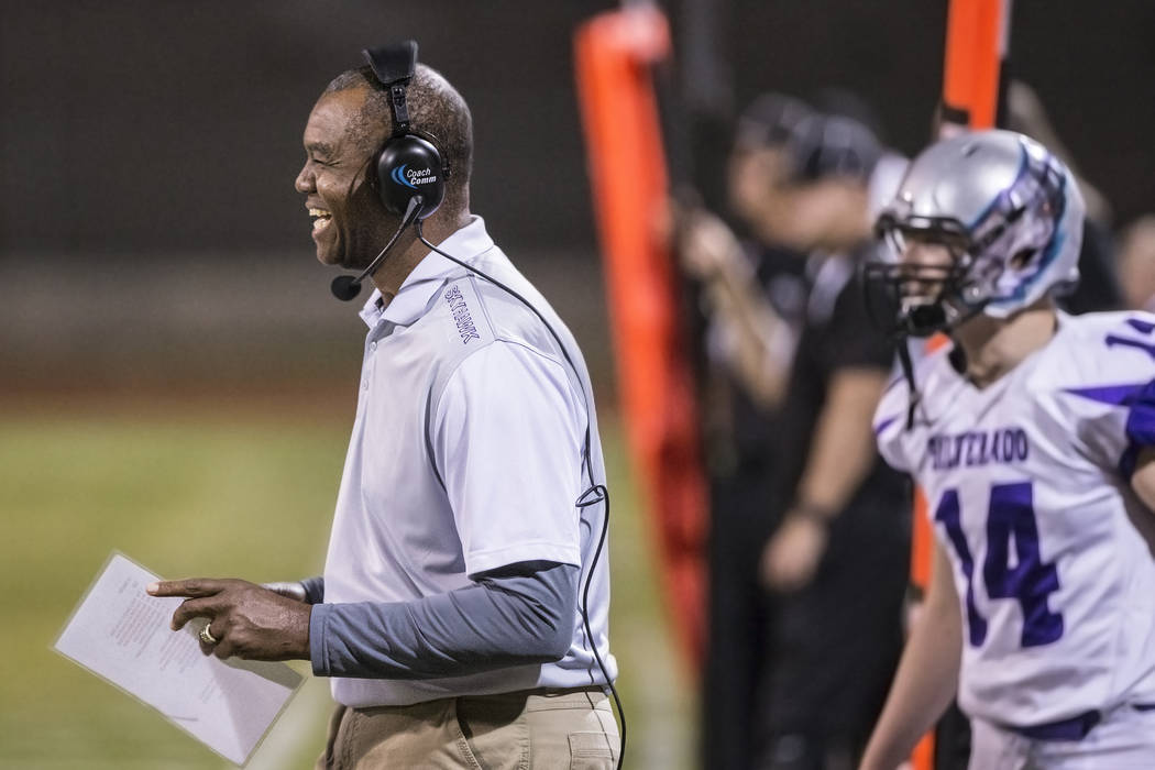 Silverado head coach Randall Cunningham laughs with his players during the Sunrise Region quarterfinal's on Friday, Nov. 4, 2016, at Las Vegas High School, in Las Vegas.  Benjamin Hager/Las Vegas  ...
