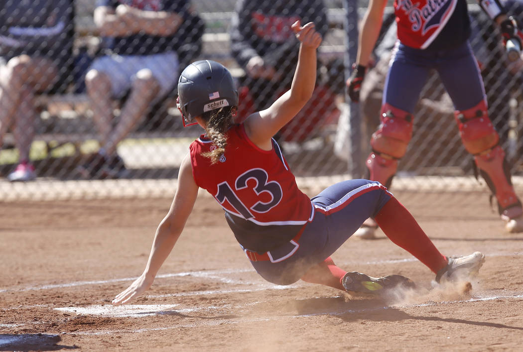 Liberty's Ashleigh Rodriguez (13) scores a run against Coronado during the first inning of a high school softball game at Coronado High School on Saturday, April 1, 2017, in Henderson. (Christian  ...