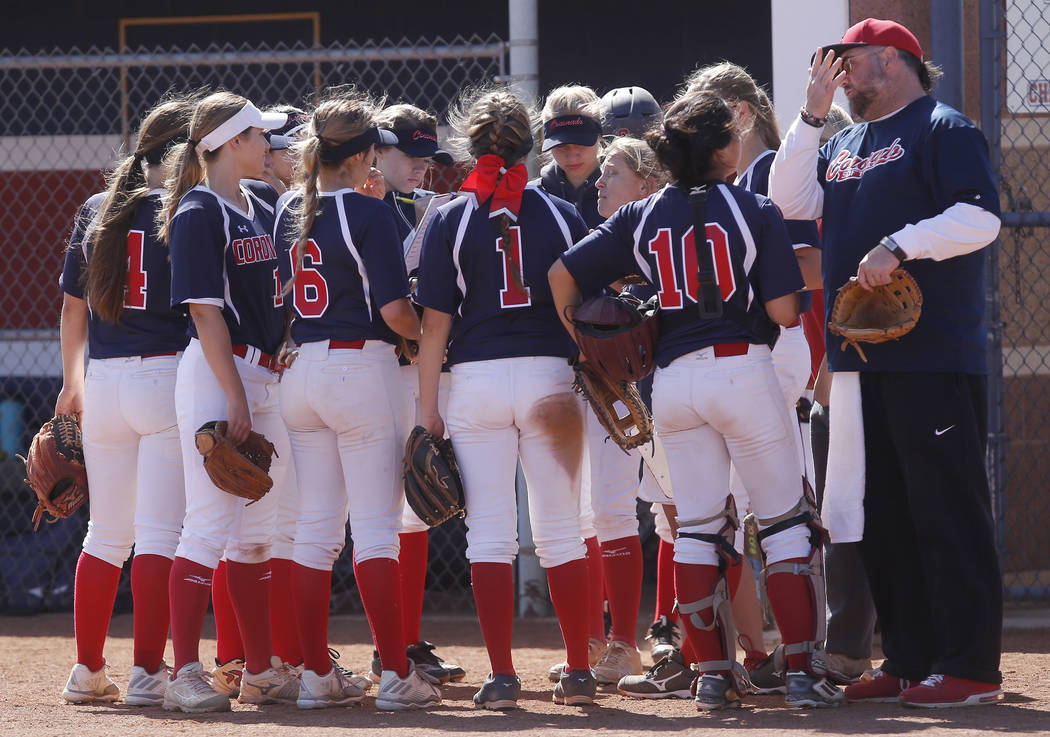 Coronado players huddle during the second inning of a high school softball game against Liberty at Coronado High School on Saturday, April 1, 2017, in Henderson. (Christian K. Lee/Las Vegas Review ...