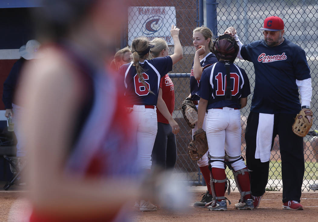Coronado players huddle during the third inning of a high school softball game at Coronado High School on Saturday, April 1, 2017, in Henderson. (Christian K. Lee/Las Vegas Review-Journal) @chrisk ...
