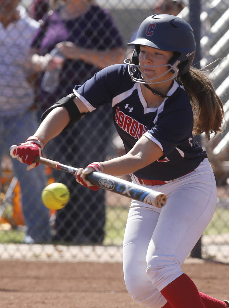 Coronado's Dylan Underwood (4) bunts during the third inning of a high school softball game against Liberty at Coronado High School on Saturday, April 1, 2017, in Henderson. (Christian K. Lee/Las  ...