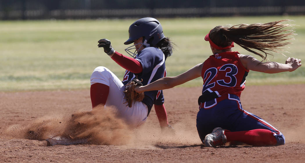 Coronado's Alexis Okamura (2) is safe at second base as Liberty's McKenna Hefley (23) attempts to tag her out during the third inning of a high school softball game at Coronado High School on Satu ...