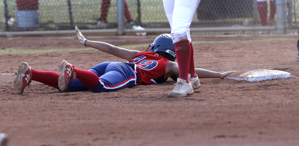 Liberty's Alyssa Tolentino (19) dives for third base after attempting to steal during the fourth inning of a high school softball game against Coronado at Coronado High School on Saturday, April 1 ...