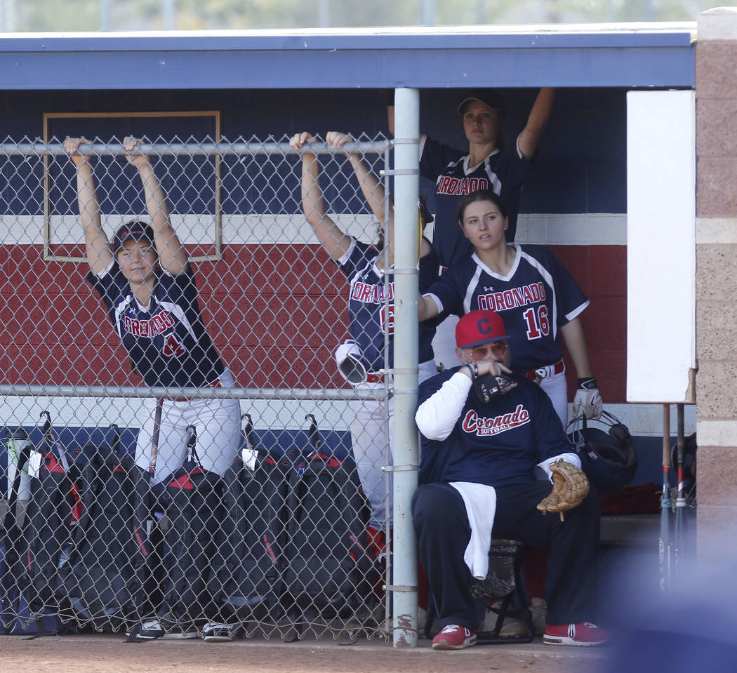 Coronado players watch the game from the dugout during the fourth of a high school softball game at Coronado High School on Saturday, April 1, 2017, in Henderson. (Christian K. Lee/Las Vegas Revie ...