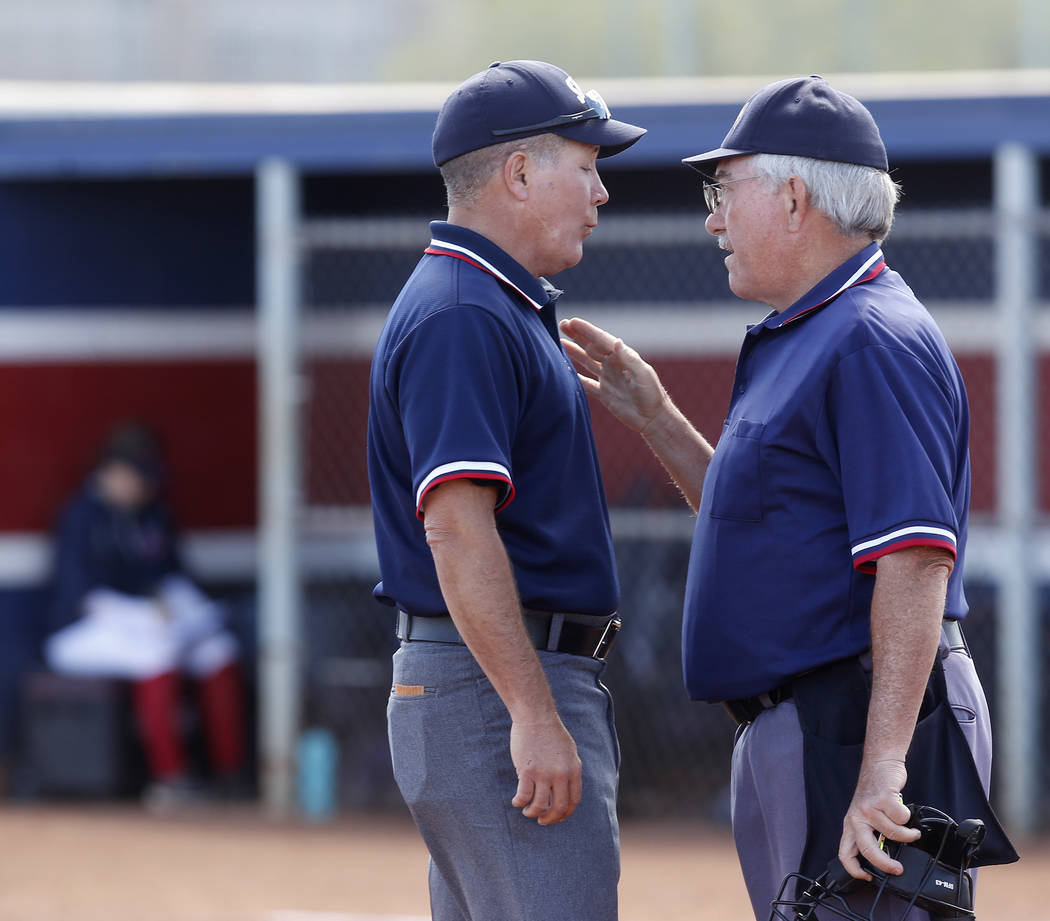 Referees discuss a call during the fourth inning of a high school softball game at Coronado High School on Saturday, April 1, 2017, in Henderson. (Christian K. Lee/Las Vegas Review-Journal) @chris ...