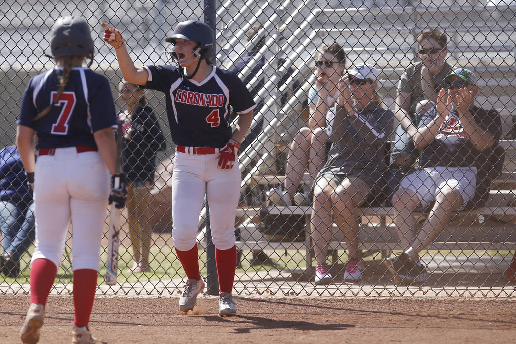 Coronado's Dylan Underwood (4) reacts after scoring a run against Liberty during the second inning of a high school softball game at Coronado High School on Saturday, April 1, 2017, in Henderson.  ...