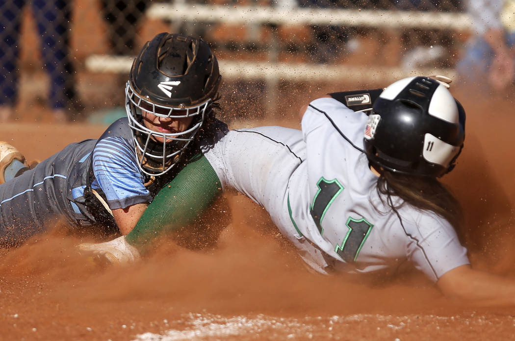 Palo Verde's Keyana Neveu (11) clashes with Centennial's Makenzie Ball (9) as Neveu scores a run during the fourth inning of a high school softball game at Palo Verde High School on Monday, April  ...
